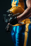 Player with american football helmet in hand. Muscular player with american football helmet in hand. Contact sport Stock Photography