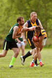 Player Avoids Being Tackled In Amateur Australian Rules Football Game. Roswell, GA, USA - May 17, 2014:  A player tries to avoid being tackled in an amateur club Stock Photos