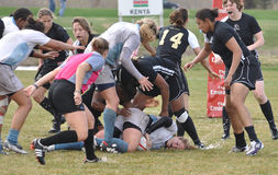 Player Being Tackled in Women's Rugby Match Stock Photography
