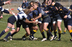 Player Being Tackled in a Women's Rugby Match. Navy player being tackled in a women's collegiate rugby match between Navy and the Brigham Young University (BYU) Stock Photography