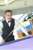 Player in billiards ready to shoot on ball Stock Photography