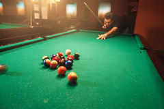 Player breaks a pyramid in billiards. Stock Image