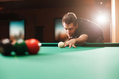 Player breaks a pyramid in billiards. Royalty Free Stock Photo