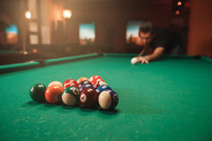 Player breaks a pyramid in billiards. Stock Images