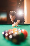 Player breaks a pyramid in billiards. Stock Photos