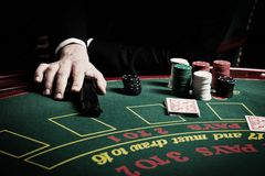 The player in the casino. Poker, gun, card game stock image
