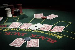 The player in the casino. Poker, gun, card game royalty free stock photos