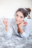 Player digital music through headphones. Player some digital music through her headphones Royalty Free Stock Images