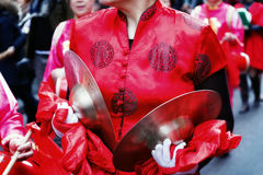 Player of the dishes, traditional Chinese dress Royalty Free Stock Photos