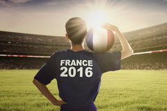 Player of Euro 2016 carrying ball on his shoulder Royalty Free Stock Photography