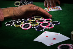 The player gather the chips stack when the points over rival on stock photography