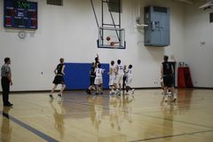 High school basketball game. A player going for the score during a high school basketball game stock images