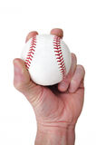 Player Gripping a New Baseball. Isolated on White Royalty Free Stock Images