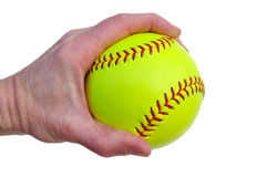 Player Gripping a Yellow Softball stock photography