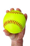 Player Gripping a Yellow Softball Stock Photo
