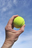 Player Gripping a Yellow Tennis Ball Royalty Free Stock Photos
