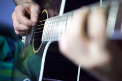 Player guitar. Close shot of boy playing guitar royalty free stock images