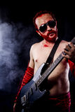 Player, guitarist with electric guitar black, wearing face paint Royalty Free Stock Image