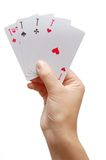 Player hand revealing Four Aces Stock Photos