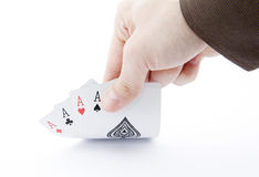 Player hand revealing four aces Royalty Free Stock Image