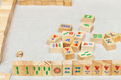 Player hand from wooden tiles in mahjong game Stock Photography