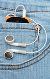 Player with headphones in the pocket Stock Images