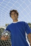 Player Holding Football royalty free stock images
