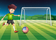 A player kicking the ball with the flag of USA Royalty Free Stock Photos