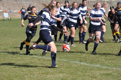Player Kicking Ball in Women's College Rugby. BLAINE, MN - APRIL 30: Unidentified BYU player about to kick the ball in a women's collegiate rugby match between stock image