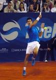 Player Novak Djokovic return a ball Stock Images