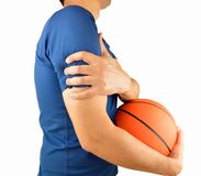 Player with pain in shoulder. Shot of a basketball player with a shoulder injury isolated over white background Stock Image
