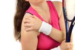 Player with pain in shoulder. Shot of a tennis player with a shoulder injury isolated over white background Royalty Free Stock Photos