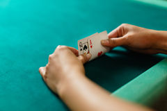 Player peeking cards in Blackjack game royalty free stock photo