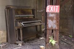 Player piano and exit sign Stock Photo