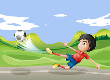 A player playing soccer at the street Royalty Free Stock Photography