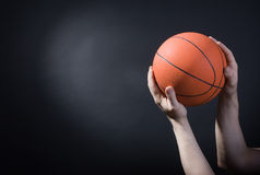 Player plays with a basketball Royalty Free Stock Photo