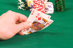 The player in poker. As of diamonds and the king in a hand of the player Stock Photo