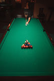 Player prepares to breaks a pyramid in billiards. Royalty Free Stock Photography