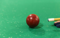 The player is preparing to blow on a billiard ball Royalty Free Stock Image
