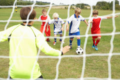 Player ready to score goal in Junior 5 a side Stock Photo