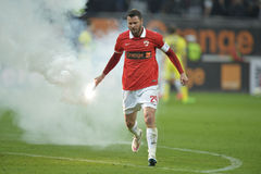 Player remove flares from the football pitch Stock Photos