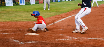Player running to the base to get one point in a baseball match Royalty Free Stock Photography