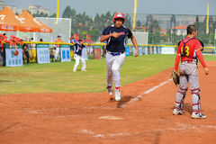 Player running to the base to get one point in a baseball match Stock Image