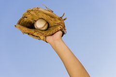 Player's Hand With Glove And Ball Royalty Free Stock Photo