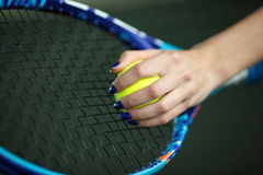 Player`s hand with tennis ball preparing to serve stock image