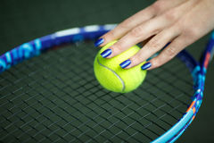 Player`s hand with tennis ball preparing to serve Royalty Free Stock Photos
