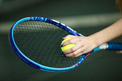 Player`s hand with tennis ball preparing to serve Stock Photography