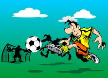 Player scores a goal. Football player running to score a goal Royalty Free Stock Image