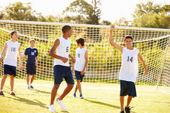 Player Scoring Goal In High School Soccer Match. Happy Player Scoring Goal In High School Soccer Match Cheering Royalty Free Stock Photo