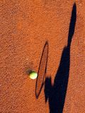 Player in the shadow. Tennis player in the shadow stock photo